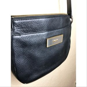 DKNY black with gold detailing crossbody bag.